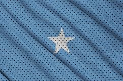 Somalia flag printed on a polyester nylon sportswear mesh fabric. With some folds royalty free illustration