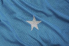 Somalia flag printed on a polyester nylon sportswear mesh fabric. With some folds royalty free stock image