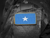 Somalia flag on soldiers arm collage.  royalty free stock images