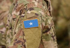 Somalia flag on soldiers arm collage.  stock image