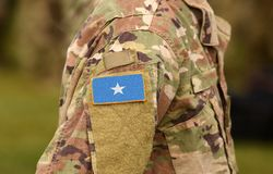 Somalia flag on soldiers arm collage.  stock photography