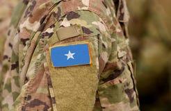 Somalia flag on soldiers arm. Somali army collage.  royalty free stock photo