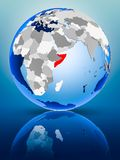 Somalia on globe. Somalia on political globe standing on reflective surface. 3D illustration stock photos