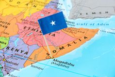 Somalia map and flag pin. Somalia paper flag pin on a map, exotic travel concept Stock Image