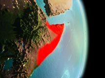 Somalia in morning from orbit. Early morning view of Somalia highlighted in red on planet Earth. 3D illustration. Elements of this image furnished by NASA stock photos