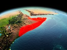 Somalia on planet Earth in space. Morning above Somalia highlighted in red on model of planet Earth in space. 3D illustration. Elements of this image furnished royalty free stock photos