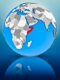Somalia on political globe. Somalia on globe reflecting on surface. 3D illustration royalty free stock photos