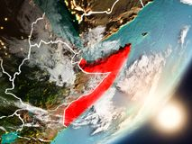 Sun rising above Somalia from space. Somalia from space with highly detailed surface textures and visible country borders. 3D illustration. Elements of this stock photo