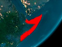 Somalia from space at night. Night view of Somalia highlighted in red on planet Earth with atmosphere. 3D illustration. Elements of this image furnished by NASA stock image