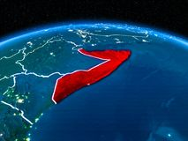 Somalia from space at night. Orbit view of Somalia highlighted in red with visible borderlines and city lights on planet Earth at night. 3D illustration royalty free stock image