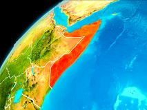 Somalia from space. Orbit view of Somalia highlighted in red with visible borderlines on planet Earth. 3D illustration. Elements of this image furnished by NASA stock image
