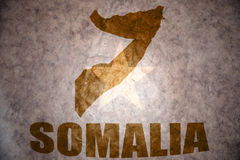 Somalia vintage map. Somalia map on a vintage somalia flag background royalty free stock image