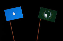 Somalian flag with African Union flag on black. Background stock photos