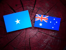 Somalian flag with Australian flag on a tree stump stock photo