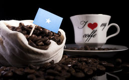 Somalian flag in a bag with coffee beans on black. Background Royalty Free Stock Photo