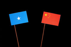 Somalian flag with Chinese flag on black. Background Royalty Free Stock Images