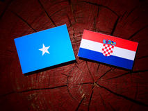 Somalian flag with Croatian flag on a tree stump Stock Photo
