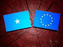 Somalian flag with EU flag on a tree stump isolated. Somalian flag with EU flag on a tree stump Stock Photography