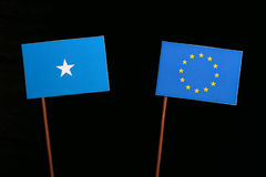 Somalian flag with European Union EU flag on black. Background stock photography