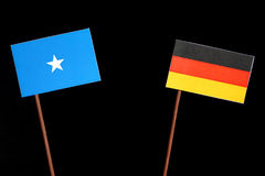 Somalian flag with German flag on black. Background stock images