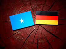 Somalian flag with German flag on a tree stump Stock Photos