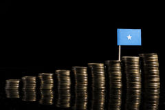 Somalian flag with lot of coins  on black. Background Royalty Free Stock Images