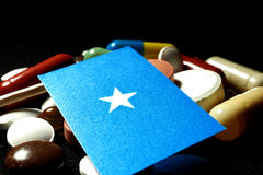 Somalian flag with lot of medical pills isolated on black backgr. Ound Stock Image