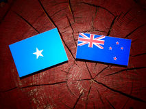 Somalian flag with New Zealand flag on a tree stump isolated. Somalian flag with New Zealand flag on a tree stump Royalty Free Stock Photo