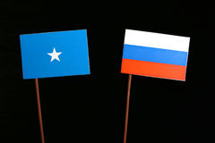 Somalian flag with Russian flag on black. Background Stock Photos
