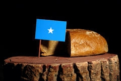 Somalian flag on a stump with bread stock images