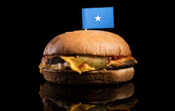 Somalian flag on top of hamburger  on black. Background Royalty Free Stock Photo