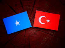 Somalian flag with Turkish flag on a tree stump Royalty Free Stock Photos