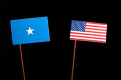 Somalian flag with USA flag on black. Background stock photo
