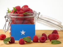 Somalian flag on a wooden panel with raspberries isolated on a w. Hite background royalty free stock photography