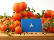 Somalian flag on a wooden panel with tomatoes isolated on a whit. E background Stock Image
