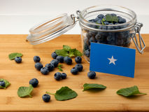 Somalian flag on a wooden plank with blueberries  on whi. Te Stock Images