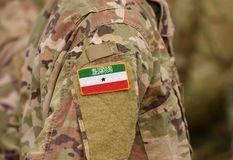 Somaliland flag on soldiers arm collage.  royalty free stock photos