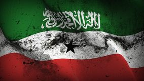Somaliland grunge dirty flag waving on wind. Somaliland background fullscreen grease flag blowing on wind. Realistic filth fabric texture on windy day Royalty Free Stock Photo