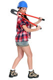 Soman with boltcutters. Woman carrying boltcutters over her shoulders Stock Images