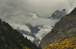 Somber Caucasus. This is somber summits in Caucasus mountains in fall Stock Images