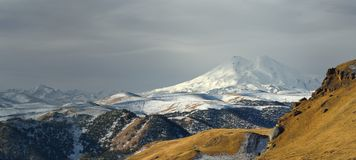 Somber Elbrus. This is somber day in Caucasus mountains,Elbrus in winter Stock Photos