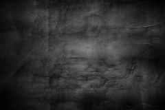Sombere muurachtergrond, de zwarte oppervlakte van het textuurcement Stock Afbeelding