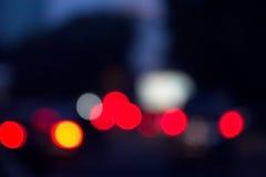 Sombere rode lichtenachtergrond Royalty-vrije Stock Afbeeldingen