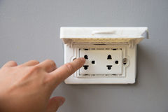 Sombody touch thailand plug socket with the cover protection Stock Images