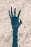 Sombra asustadiza de la mano Foto de archivo