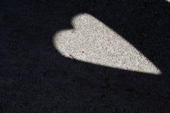 Sombra con un corazón Imagen de archivo libre de regalías