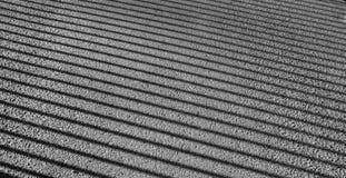 Sombra de barras de un cercado en el asfalto Imagen de archivo libre de regalías
