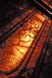 Sombra de la cerca del hierro labrado Imagenes de archivo