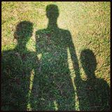 Sombra de la familia Imagenes de archivo