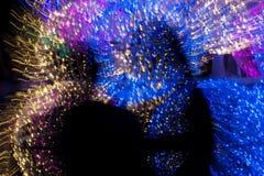 Sombra de la forma humana por multicolor de la iluminación de la pintura Imagen de archivo libre de regalías